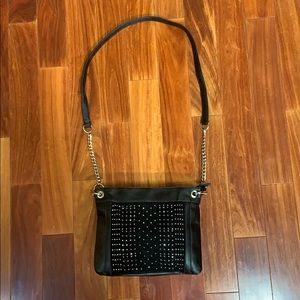 Black leather bag with suede rhinestone detail